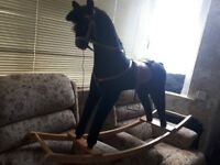 Black mamas and Papas rocking horse very good condition
