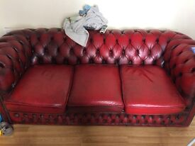Chesterfield sofa, at least 30 years old. Good condition considering it's age.