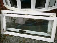 2 wooden doors with glass panel