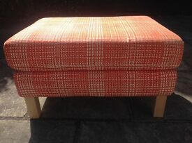IKEA orange/cream footstool and matching cushion.