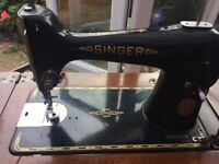 1951 Singer Sewing Machine set in table with cast iron treadle