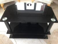 "Tempered black glass TV stand 20""x28""x18"""