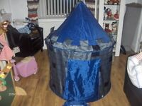 kids pop up castle play tent navy with storage bag 51 in high x 39in diamater.