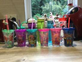 Six Disney cups with straws plus three Camelbak waterbottles