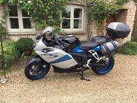 BMW K1200s includes panniers, top box, tank protector, tank bag and has aftermarket exhaust.
