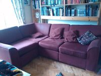 burgandy corner sofa which can be divided into up to 5 chairs or 2 small sofas with and without arms