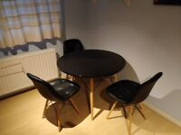 Set of Charles Eames inspired DSW Eiffel Dinner table and 3 Buttoned black PU leather chairs.