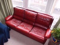 Red leather sofa and armchairs set