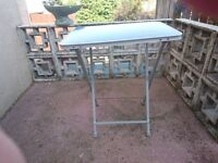 Folding table suitable for garden/caravanning/camping