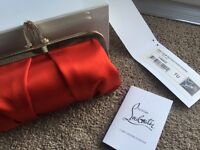 Elegant red satin clutch by Christian Louboutin
