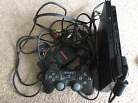 PlayStation 2 slim console + 11 games