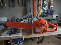 Husqvarna 350 Chainsaw (light usage) excellent condition along with a Triton Super Jaws log holder