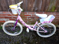 Girl's BMX bike with front basket and dolly seat