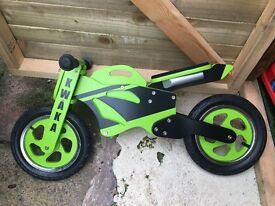 Halfords wood KWAKA balance bike with stand