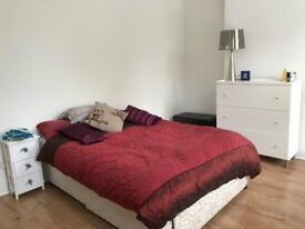Large bright room in friendly house, handy location.