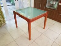 Solid Cherry Wood extendable Dining Table with Glass top. seats 4-8.