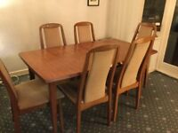Solid wood extendable dining table with 6 chairs.