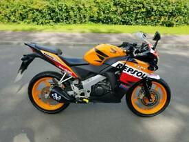 Honda cbr 125 repsol colour in excellent condition with very low miles