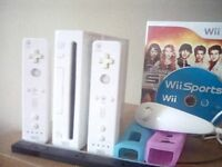 Nintendo Wii for sale,2remotes, nunchuck, motion bar, 2games, 2steer wheels, all cables