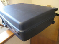 Hardly used Delsey hard shell suitcase with 2 wheels