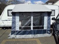 ALMOST NEW CARAVAN PORCH AWNING, EXCELLENT CONDITION. THIS HAS HARDLY BEEN USED, LOOKS NEW