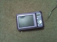 Purple samsung digital camera perfect condition with 4GB SD card and the cables.