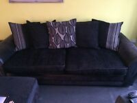 4 Seater black fabric sofa with foot stall