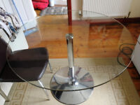 Glass circular dining table and 4 chairs with new covers
