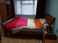 Large room to let in 2 bedroom flat ,King size bed ,fitted wardrobe,furnished.