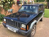 Black Cherokee TD sport estate jeep