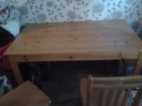 wooden table and four chairs good condition