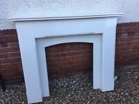 Solid granite fire surround in cream.