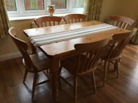 Pine dining table and six chairs with matching dresser and corner unit