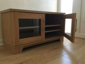 Tv unit natural oak effect, pristine condition, buyer must collect.