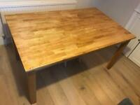 Extendable wooden dining table