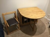John Lewis butterfly drop leaf table with 4 padded chairs that can be stored in cupboard underneath.