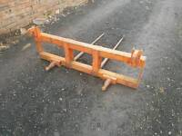 Tractor front loader bale spike with two spikes