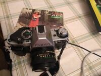 Canon AE-1 35mm film camera with additional lenses