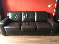 Three seater leather sofa in good condition for sale.