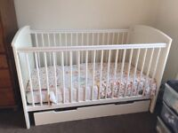 Cot with storage drawer and changing station, turns into toddler bed