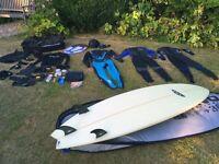 Surfboard by Fluid Juice, O'Neil wetsuits, bag of kit.
