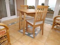 Dining table and 2 chairs - ideal for flat or conservatory. Folding top.