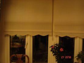 2 white roller blinds width 109x160cms length