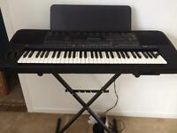 Yamaha keyboard on stand with accessories
