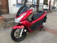 HONDA PCX 125cc DRAGON RED 12 plate stunning hpi clear!!!
