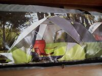 A new unopen 6 persons tent for sale just 60 pound only from Queensbury opposite of station