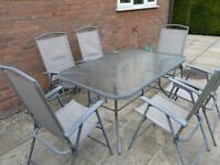 Garden Table with Glass Top and 6 Chairs - In good order