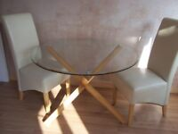 Round Dining Table Glass Top and Oak Legs new and still in boxes. £100.