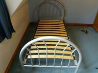 Two single metal bed frames