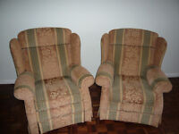 Two Parker Knoll winged armchairs, one reclining.